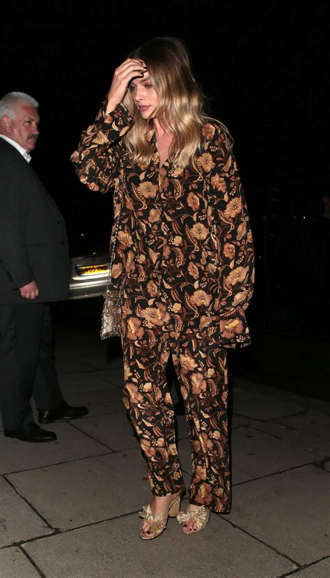 Margot Robbie in a Floral Suit Arrives at Once Upon a Time
