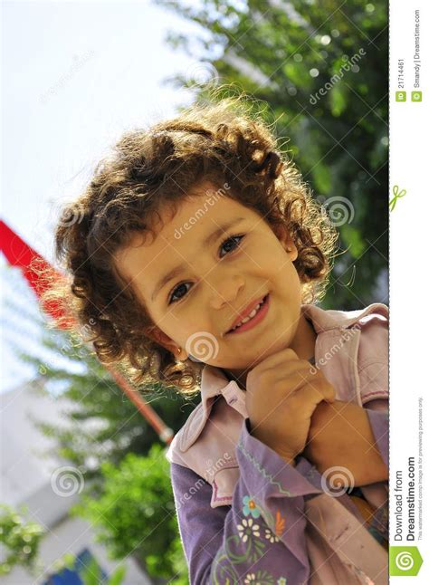 Cute Little Girl With Blond Curly Hair Editorial Photo
